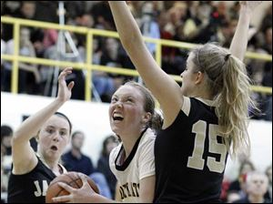 Sylvania Northview's Maddie Cole (44) drives to the net against Perrysburg's Maddy Perry (15).