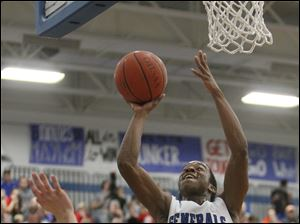 Anthony Wayne High School player Ose Omofoma, 22, puts up a shot against Bowling Green.