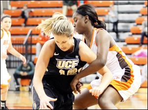 Bowling Green State University's Jasmine Matthews and  UCF's Kayli Keough fight for the ball.