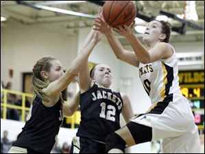 Sylvania Northview's Kendall McCoy (40) takes a shot against Perrysburg's Allex Brown (35) and Maddy Williams (12).