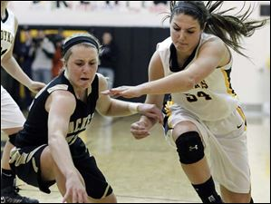 Perrysburg's Maddy Williams (12) battles Sylvania Northview's Kendall Jessing (54).