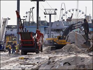 Crews work work to replace the Superstorm Sandy destroyed boardwalk in Seaside Heights, N.J., Thursday.