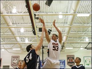 Otsego's senior A.C. Limes (53) puts up two points over Lake's senior Marcus Pierce (54).