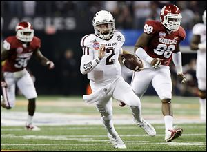 Texas A&M's Johnny Manziel finds a lot of running room against Oklahoma. Johnny Football set a Cotton Bowl record with 516 yards of offense.