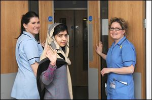 Malala Yousufzai says goodbye as she is discharged from a Birmingham hospital to continue her rehabilitation at her family's temporary home in the area.