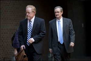 Sen. Michael Crapo (R., Idaho), right, arrives at Alexandria General District Court in Alexandria, Va