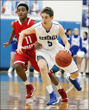 Anthony Wayne's Hunter Debo, who scored 11 points, drives past Bowling Green LaMonta' Stone.