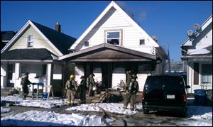 Fire crews work on a house fire at 270 E. Pearl St. in North Toledo.