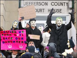 Activists from the online group Anonymous, outraged by the prospect of athletes possibly being given preferential treatment, protest at the Jefferson County Courthouse in Steubenville.
