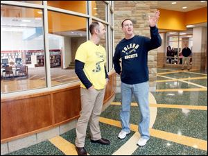 Adam Fineske, Executive Director of Curriculum and Instruction, left, looks at the foyer with parent Jeff Taylor.