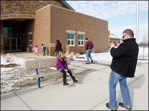 Eric Whitman takes a picture of his daughter Mya Whitman, 8.
