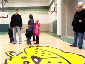 Mickey Alexander, right, looks at the cub mascot on the floor while touring the gym with her family, the Fellers, from left: Ethan Feller, 2, dad Greg Feller, son Jack Feller, 2, mother Christine Feller, and their daughter Katie Feller.