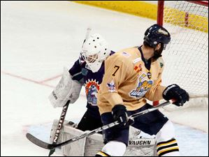 Toledo Walleye Brandon Svendsen looks back to see the puck blocked by Orlando goalie John Curry.
