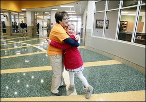 Principal Toni Gerber hugs third grader Madison Taylor while she welcomed students and families Saturday to tour the new Central Trail Elementary for the first time.