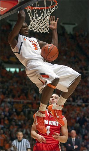 Illinois guard Brandon Paul dunks as Ohio State guard Aaron Craft looks on Saturday in Champaign, Ill.