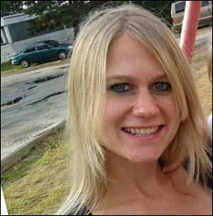 Rachel Kominek, 26, of Toledo, was pronounced dead at the scene Thursday.