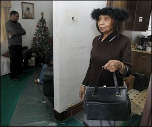 Toledoan Eva White holds her purse that a thief grabbed from her near a store on Collingwood Boulevard. A passer-by tackled the man and retrieved the purse, which contained a lottery ticket she had pur-chased minutes before. The unidentified man who caught the thief released him.