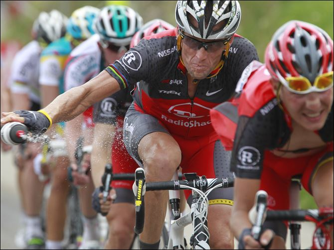 Armstrong Doping Cycling Lance Armstrong throws out his water bottle in the last kilometers of the climb toward Station les Rousses, France, during the seventh stage of the Tour de France cycling race.