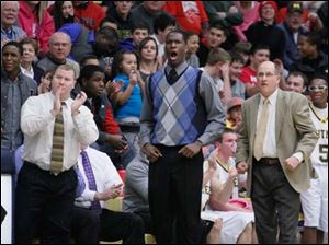Whitmer player Nigel Hayes, center, and head coach Bruce Smith, right, like what they see during the first quarter against Bedford.