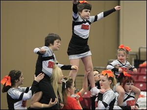 Sparklers cheerleaders Alvin Gibson, left,  Izzie Vandyke, and Kayliegh Long, 6, all of Toledo. Sparklers is a special needs team from CheerWorks Sparks of Toledo.