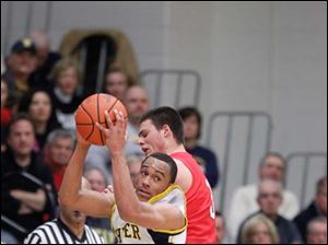 Whitmer's Ricard Smith (10) steals the pass intended for Bedford player Dennis Guss (3) during the second quarter.