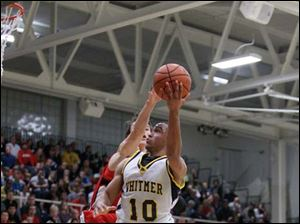 Panthers player Ricardo Smith (10) beats Mules player Jackson Lamb (32) as he makes a layup during the second quarter.