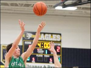 Ottawa Hills'  Geoff Beans (3) hits a three point shot against Toledo Christian's Eric Cellier (5).