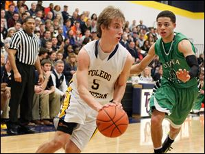 Toledo Christian's Eric Cellier (5) tries to maneuver around Ottawa Hills' AJ King (11) as he heads to the net.
