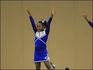 De'Janay Gary, 10, is held aloft by teammates Whitney Bankston, 13, left, Miyon Mickles, 10, and Jaiden Taylor, 14. They are from Winterfield Venture Academy, a charter school in Toledo.