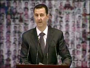 Syrian President Bashar Assad speaks at the Opera House in central Damascus, Syria. Syrian President Bashar Assad on Sunday outlined a new peace initiative that includes a national reconciliation conference and a new government and constitution.