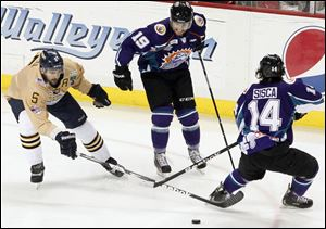 The Walleye's Wes O'Neill tries to get the puck against Orlando's Dan Gendur left, and Mathew Sisca.
