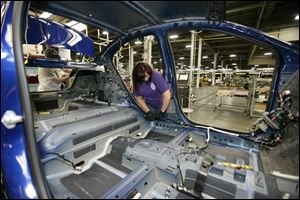 Tammy Ballard works on a Chevrolet Sonic at the General Motors Orion Assembly plant in Orion Township, Mich.
