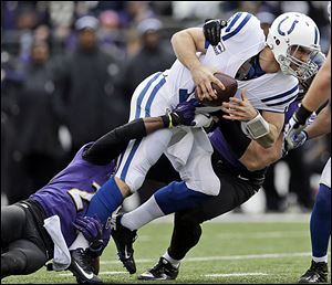 Ravens cornerback Corey Graham, left, and outside linebacker Paul Kruger sack the Colts' Andrew Luck. The rookie lost in his debut playoff game after winning 11 games this season.