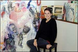 Hillview Elementary art teacher Sarah Vanni, in her studio at her Waterville home, says she disciovered her abstract style while she was a student at Bowling Green State University. Her work on exhibit in Italy is part of a show by Studio Arts Center International of Florence alumni.