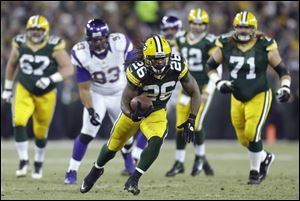 Green Bay Packers running back DuJuan Harris runs through the  the Minnesota Vikings' defense Saturday in Green Bay, Wis. The Packers won 24-10.
