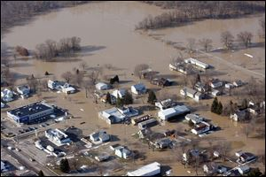 Heavy rains that mixed with melting snow pushed the Blanchard River over its banks, flooding Ottawa, Ohio, in March, 2011. The scene is familiar to area residents; devastating floods have hit the watershed area repeatedly, causing millions of dollars' worth of property losses.