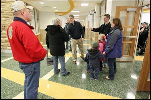 Brad Rieger, superintendent of Sylvania Schools, shakes hands with visitors at the new Central Trail Elementary on Saturday.