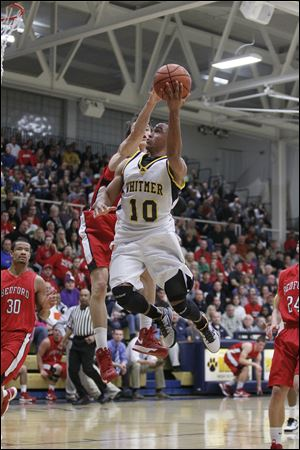 Whitmer's Ricardo Smith, who finished with 30 points, drives against Jackson Lamb.