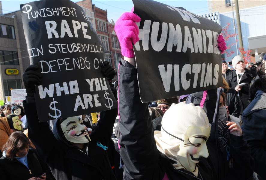 Steubenville-rally-masked-men