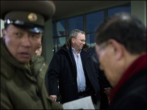 Executive Chairman of Google Eric Schmidt, center, arrives at Pyongyang International Airport in Pyongyang, North Korea today. Schmidt arrived in the North Korean capital along with former New Mexico Gov. Bill Richardson.