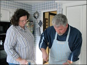 Toledoans Theresa Carroll and Tom Dimit make a quick bread. Ms. Carroll, Mr. Dimit's girlfriend, has been his caregiver since he had a life-changing stroke in October, 2011, that left him visually impaired.