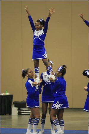 De'Janay Gary, 10, is held aloft by Winterfield Venture Academy teammates from left, Whitney Bankston, 13, Miyon Mickles, 10, and Jaiden Taylor, 14.