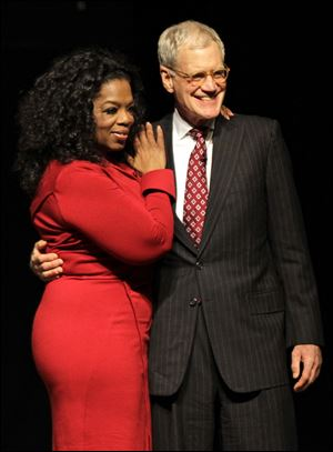 "Ball State University alumnus David Letterman, right, host of CBS's ""Late Show,"" with Oprah Winfrey following an interview at Ball State University in Muncie, Ind."