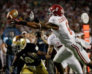 Alabama's Ha'Sean Clinton-Dix (6) intercepts a pass over Notre Dame's DaVaris Daniels (10) during the second half of the BCS National Championship college football game in Miami.