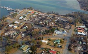 This aerial photo shows a view of Dunalley after a wildfire destroyed around 80 buildings in and around the small town, east of the Tasmanian capital of Hobart, Australia, Saturday.