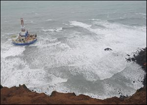 The Royal Dutch Shell drilling rig Kulluk is seen aground off a small island near Kodiak Island on New Year's Day.