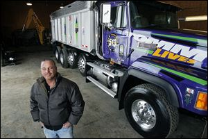 Tom Wylie, owner of Wylie & Sons Landscaping in Perrysburg Township, completed the project in time for Christmas as a present to his son Tommy, Jr., who was killed in an accident in June. The 'Crazy Plum Purple' paint on the truck was the closest match to his son's Kawasaki racing color.