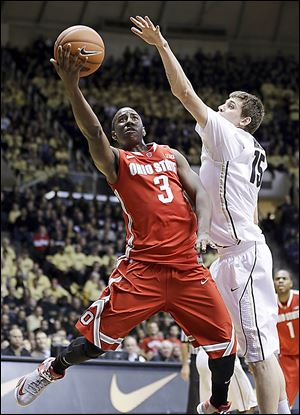 Ohio State guard Shannon Scott shoots under Purdue forward Donnie Hale in the first half Tuesday in West Lafayette, Ind.