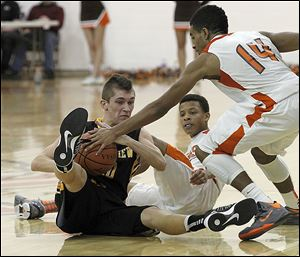 Northview's Jeff Czerniakowski tries to keep the ball from Southview's Brandon Stewart, 14, during the game at Southview in Sylvania.