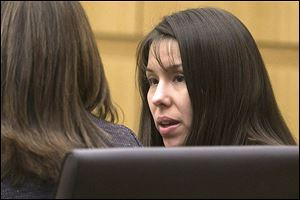 Defendant, Jodi Arias, listens during the prosecution's opening statements in Maricopa County court in Phoenix.